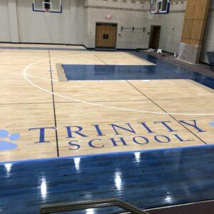 Trinity school basketball court flooring.