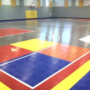 Kennesaw charter school indoor gymnasium with multi-colored flooring.