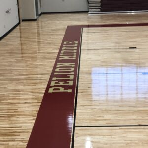Pelion middle basketball court sideline completed court flooring.