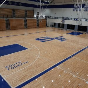 South forsyth basketball court completed basketball flooring.